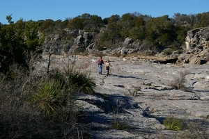 Hikers on dry river bed
