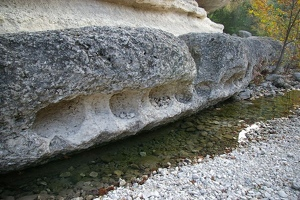 Round holes in side of rock