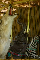 Carousel howling wolf and trumpeting elephant