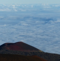Red cinder cone in front of cloud bank