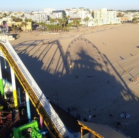 Ferris wheel shadow on beach